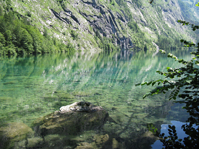 The clear, reflective waters of the lake amazed the author when she visited Germany.