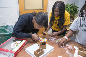 Boarding students at Randolph-Macon Academy Middle School have fun building a gingerbread house.