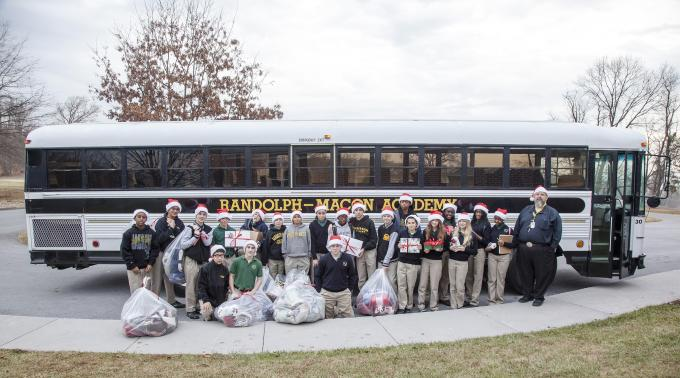 The Middle School students prepare to load the bus with their gifts for the veterans at the VA Hospital.