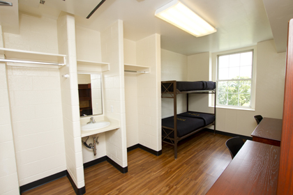 This photo shows an actual military school dorm room.