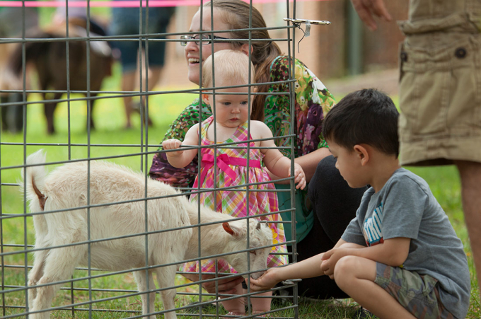 Kids enoy petting the animals at the Randolph-Macon Academy Community Day celebration