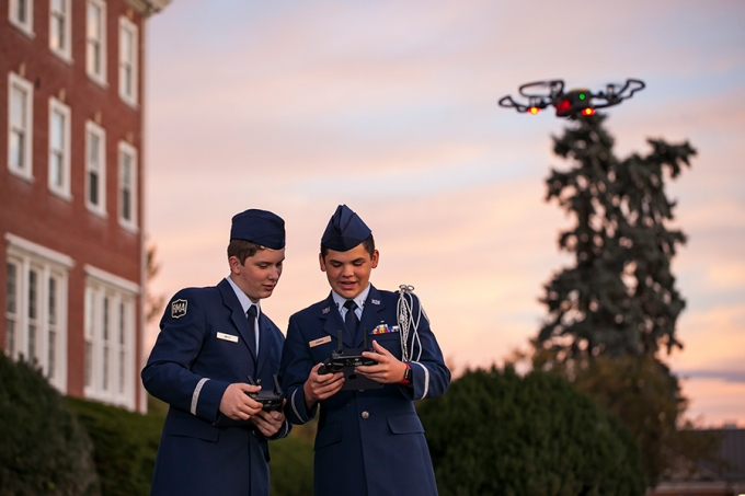 Two boarding school students take their drone for a spin at sunup on the campus of Randolph-Macon Academy