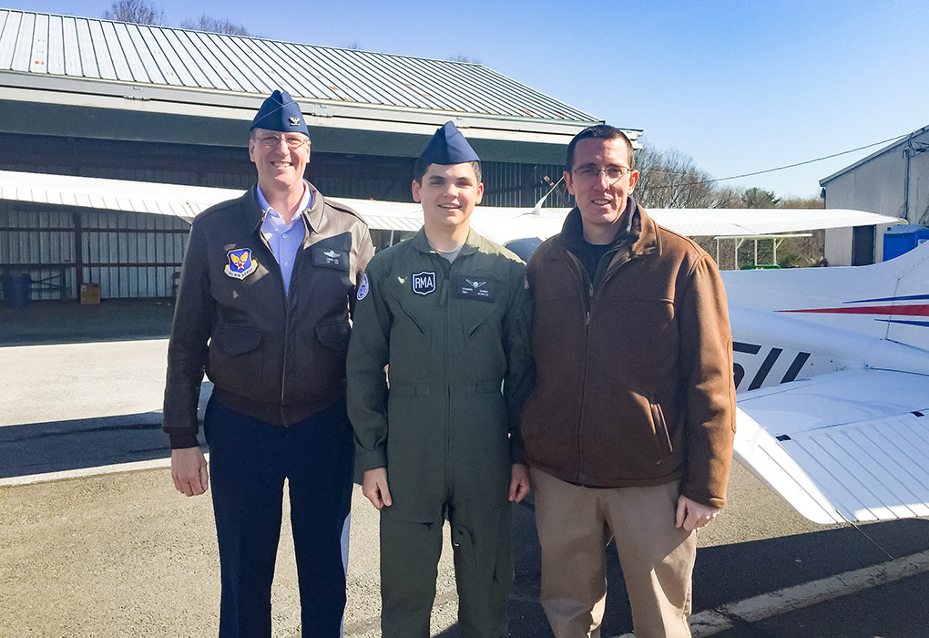 Connor Gamma '21, center, celebrates his solo with R-MA Commandant Col Frank Link, USAF, Retired (on left), and R-MA Flight Instructor Ryan Koch (on right). Photo by Todd Davis.