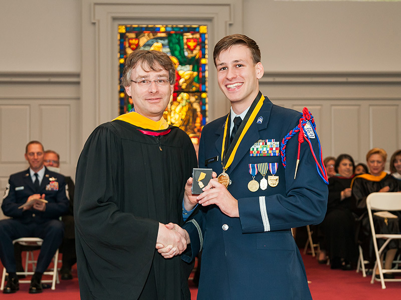 Immediately after delivering his salutatorian speech during Class Night, Ryan received the German Medal from his father, longtime R-MA teacher Stephen Latham.
