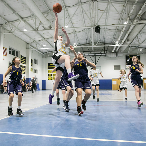 Payton Kaufman '23 goes for a lay-up during a regular-season game against Sacred Heart Academy.
