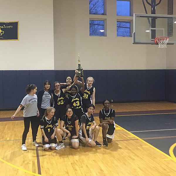The girls' team celebrates their tournament win over St. Joe's.