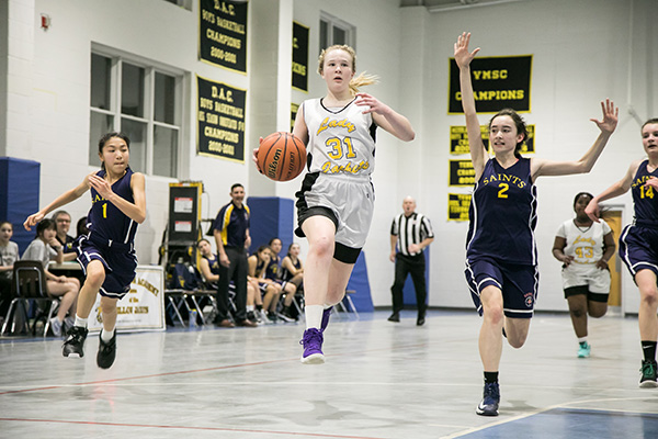 Peyton Kaufman '23 eyes the basket as she comes down the court during a home game against Sacred Heart Academy.