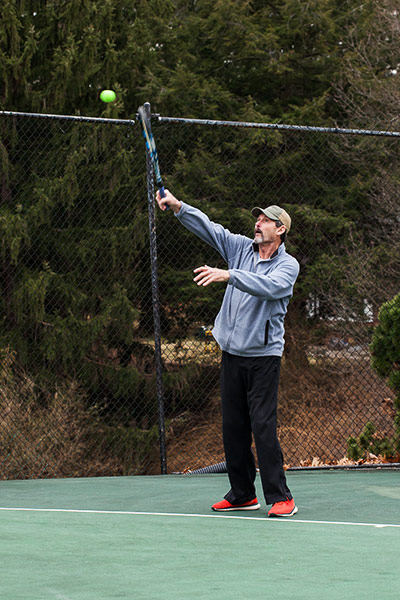 Howard Walters returned to coach the Middle School tennis team, much to the students' delight.