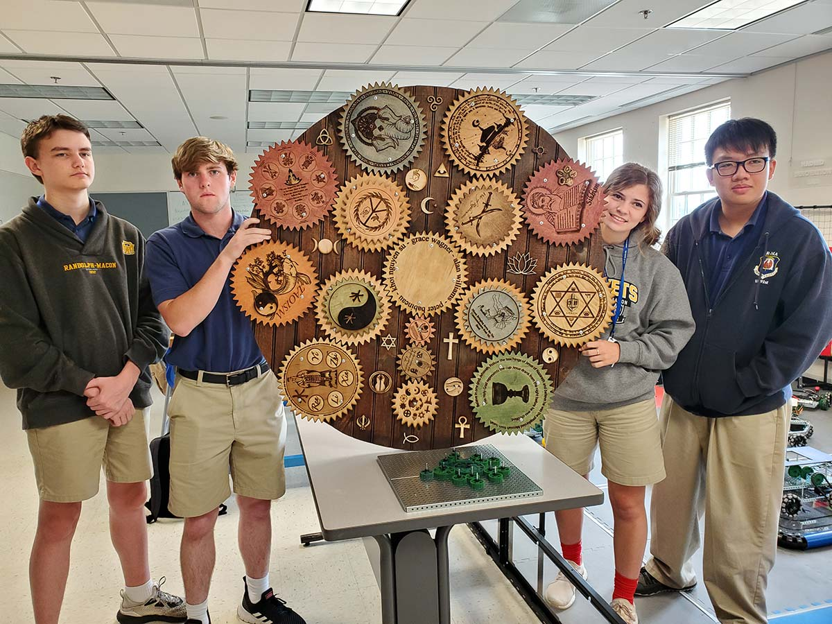 The four students in the summer World Religions class at Randolph-Macon Academy created a large project that combined their knowledge of world religions with math, engineering, graphic design, and art.