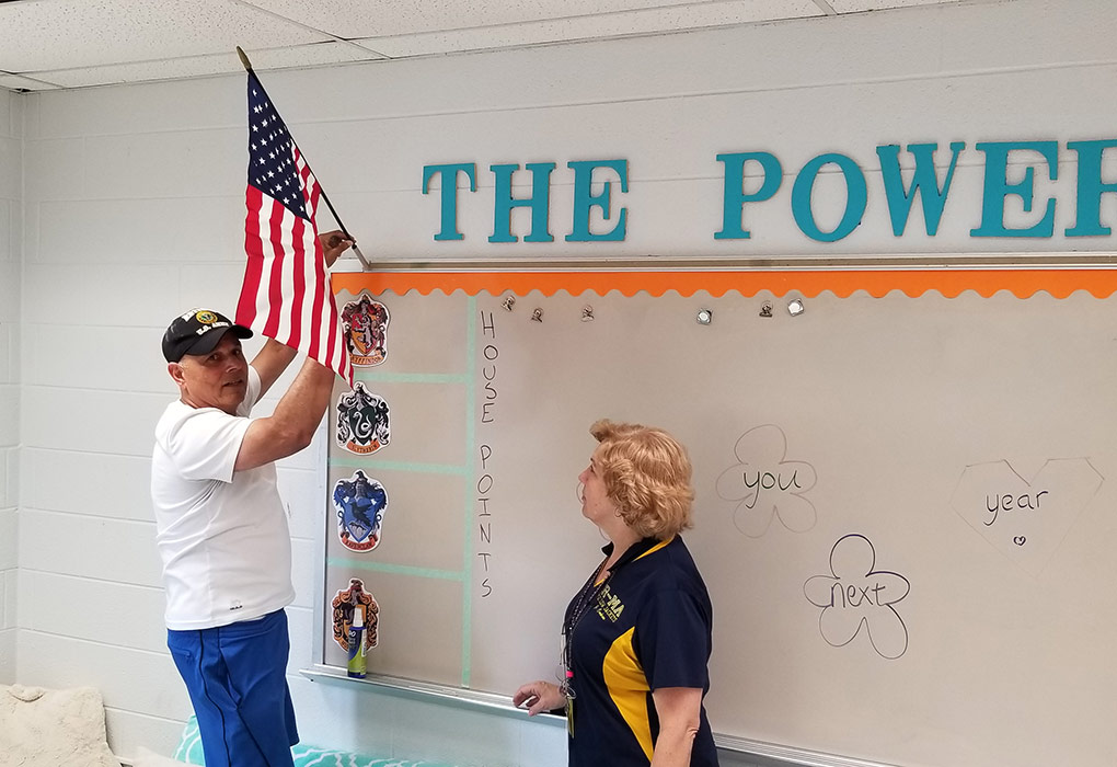 Mr. Piplani of American Legion Post 53 and Commander Cochran installed the American flags over the summer.